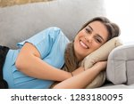 beautiful young woman relaxing... | Shutterstock . vector #1283180095