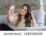 beautiful young woman relaxing... | Shutterstock . vector #1283180638