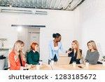 african female boss dressing... | Shutterstock . vector #1283185672