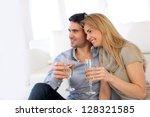 romantic couple drinking wine...   Shutterstock . vector #128321585