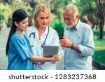senior man talking to doctor ... | Shutterstock . vector #1283237368