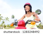 scooter driving girl riding... | Shutterstock . vector #1283248492