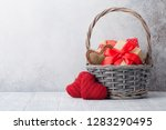 Stock photo valentine s day greeting card with gift boxes in basket with space for your greetings 1283290495