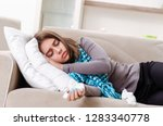 sick young woman suffering at... | Shutterstock . vector #1283340778