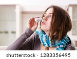sick young woman suffering at... | Shutterstock . vector #1283356495