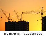 construction cranes with built... | Shutterstock . vector #1283356888