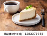 cheesecake and cup of coffee on ... | Shutterstock . vector #1283379958