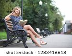 beautiful girl in the park on a ...   Shutterstock . vector #1283416618