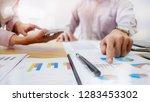 business executives negotiate... | Shutterstock . vector #1283453302
