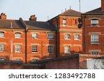terrace of red brick built...   Shutterstock . vector #1283492788