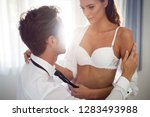 playful couple in love... | Shutterstock . vector #1283493988