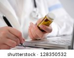 doctor writing a prescription | Shutterstock . vector #128350532