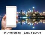 business man hand holding white ... | Shutterstock . vector #1283516905