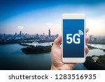 hand holding mobile smart phone ... | Shutterstock . vector #1283516935