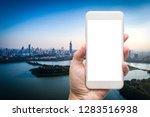 business man hand holding white ... | Shutterstock . vector #1283516938
