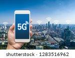 hand holding mobile smart phone ... | Shutterstock . vector #1283516962