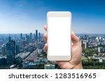 business man hand holding white ... | Shutterstock . vector #1283516965