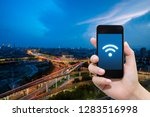 smart phone in hand and using... | Shutterstock . vector #1283516998