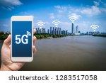 hand holding mobile smart phone ... | Shutterstock . vector #1283517058