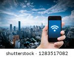 smart phone in hand and using... | Shutterstock . vector #1283517082