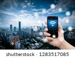 smart phone in hand and using... | Shutterstock . vector #1283517085