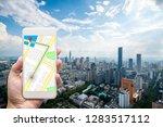 mobile gps navigation on mobile ... | Shutterstock . vector #1283517112