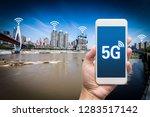 hand holding mobile smart phone ... | Shutterstock . vector #1283517142