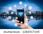 smart phone in hand and using... | Shutterstock . vector #1283517145