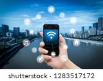 smart phone in hand and using... | Shutterstock . vector #1283517172