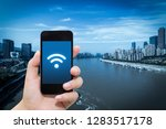 smart phone in hand and using... | Shutterstock . vector #1283517178