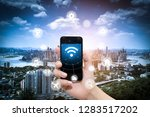 smart phone in hand and using... | Shutterstock . vector #1283517202