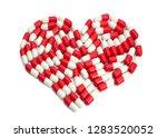 heart red capsules frame from... | Shutterstock . vector #1283520052