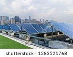 solar and modern city skyline  | Shutterstock . vector #1283521768
