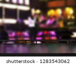 wooden table on blurred club... | Shutterstock . vector #1283543062