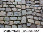 wet cobbled stone sidewalk...   Shutterstock . vector #1283583055