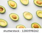 plenty of fresh avocados on... | Shutterstock . vector #1283598262