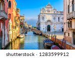 narrow canal with bridge in...   Shutterstock . vector #1283599912
