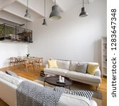 Small photo of Stylish living room with two sofas, dining table and mezzanine