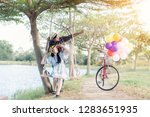 smiling young woman on a swing  ... | Shutterstock . vector #1283651935