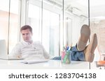 relaxed businessman using...   Shutterstock . vector #1283704138