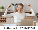 happy young woman celebrating... | Shutterstock . vector #1283704228