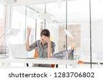 overworked businesswoman...   Shutterstock . vector #1283706802