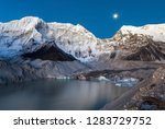 grey moraine lake and snowy... | Shutterstock . vector #1283729752