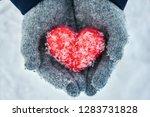 woman's hands wearing woolen... | Shutterstock . vector #1283731828