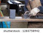 metalworker at work in his... | Shutterstock . vector #1283758942