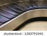 baggage conveyor belt at... | Shutterstock . vector #1283791042