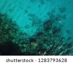 drone shot man swims in clear... | Shutterstock . vector #1283793628