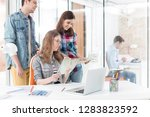 colleagues with photographs and ...   Shutterstock . vector #1283823592