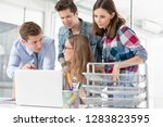 creative colleagues using...   Shutterstock . vector #1283823595