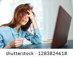 a tired woman with disheveled... | Shutterstock . vector #1283824618
